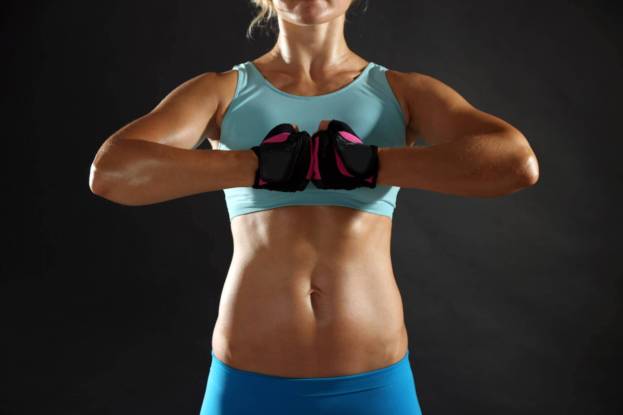 Athletic woman on dark background